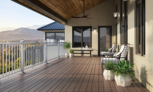 Vista Ironwood decking in 6 and 4 Inch widths paired with brushed titanium ALX Contemporary railing