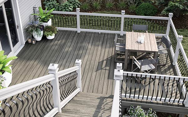 Heritage Smokehouse decking with white railing and black Baroque balusters