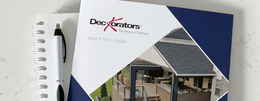 Deckorators Style Guide on table with mug