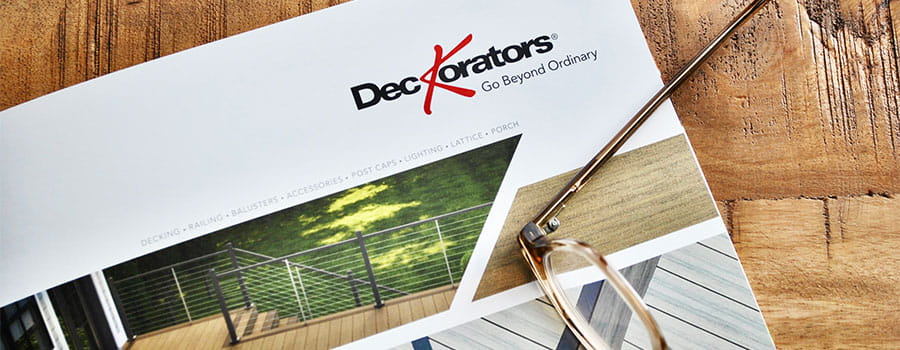 Deckorators Style Guide on table with coffee and pen