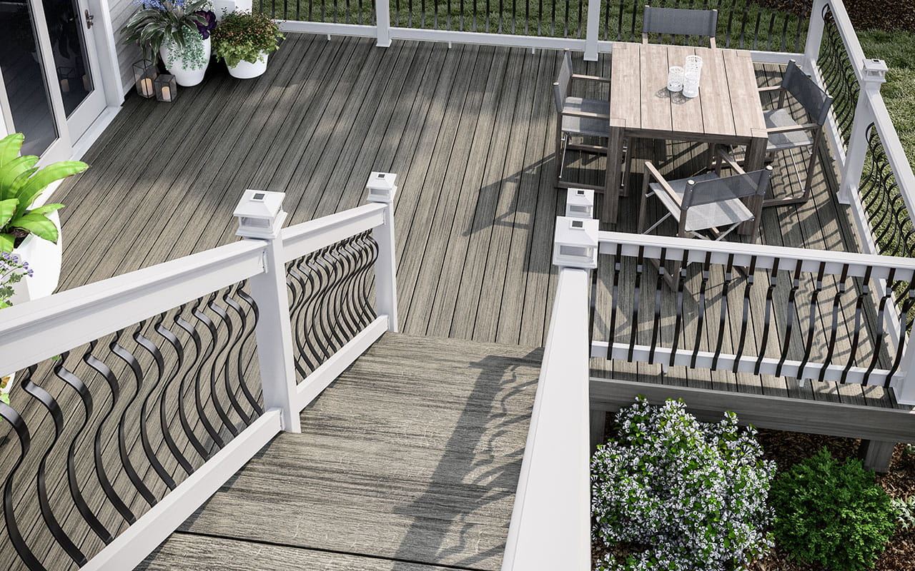 Heritage Smokehouse decking with white ALX Pro railing, black Baroque balusters and white solar post caps.