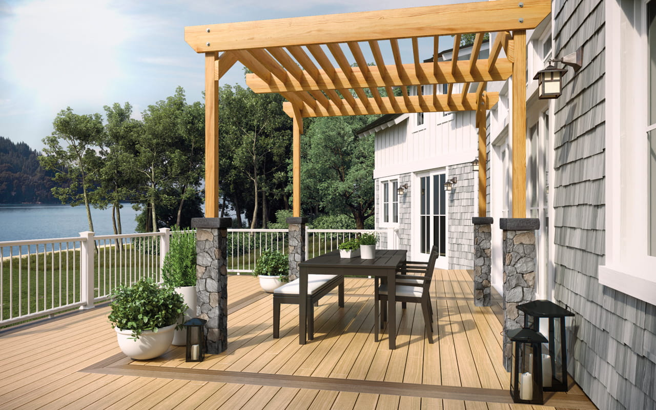 Deckorators light brown composite deck with dark brown border, Fieldstone postcovers and pergola.