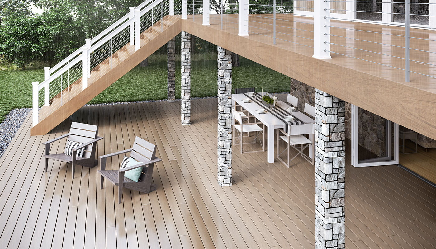Vault Hickory decking with White ALX Pro railing and Gray Cobblestone Postcovers