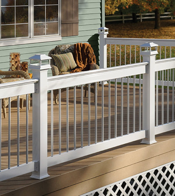 Deckorators white aluminum railing, white round balusters and white solar post caps