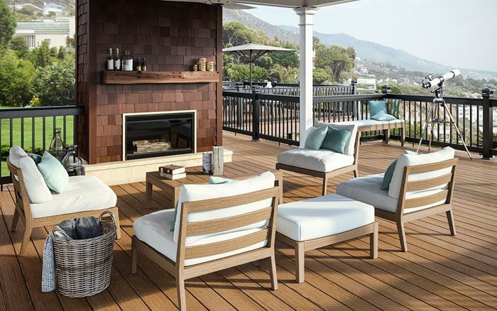 Classic Cedar composite deck boards with black aluminum railing and outdoor fireplace